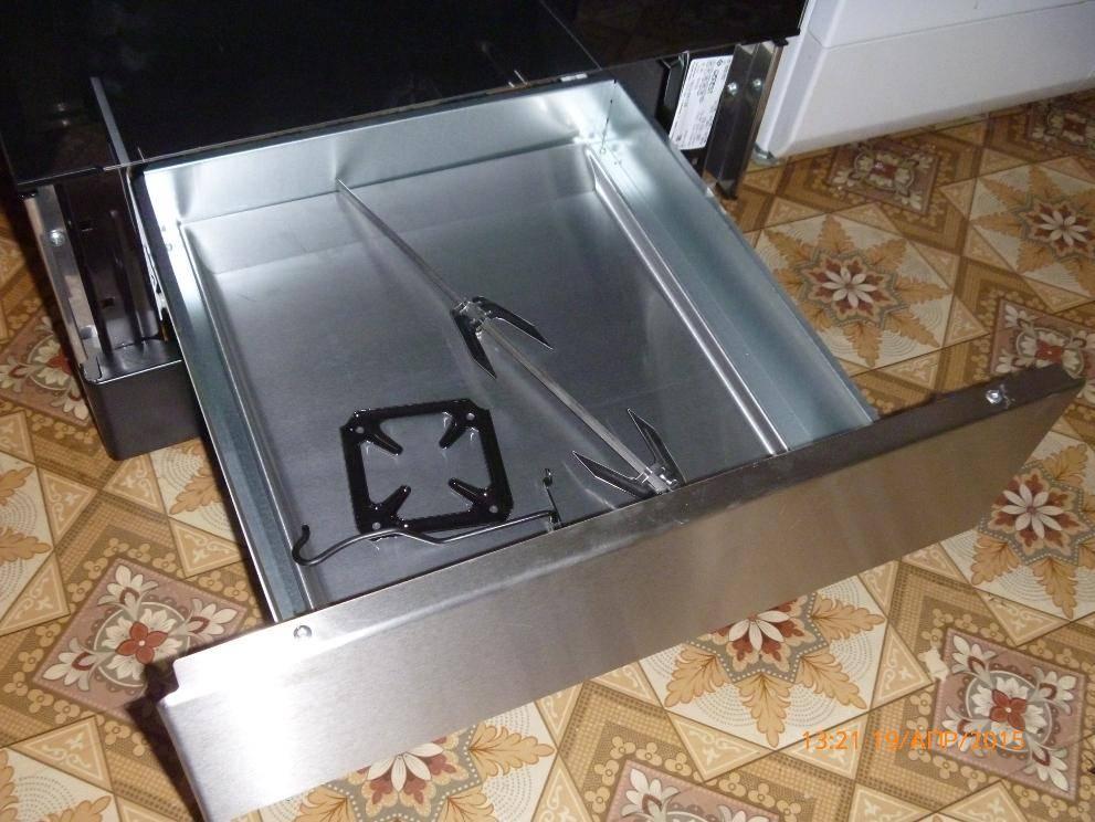 Для чего нужен нижний ящик в газовой плите: способы применения плиточного поддона