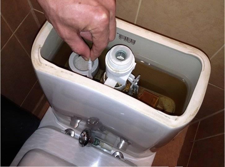 Ремонт сливного механизма бачка унитаза с кнопкой своими руками